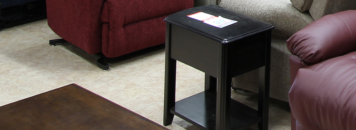 black occasional table next to couch